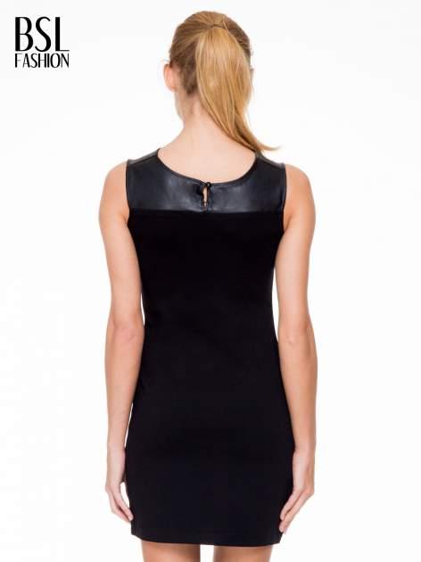 Czarna sukienka ze skórzaną górą i dekoltem typu cut out                                  zdj.                                  4