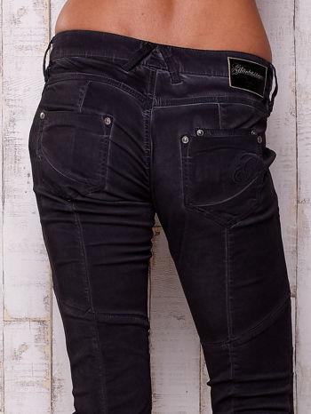 Czarne dekatyzowane spodnie z przeszyciami                                  zdj.                                  5