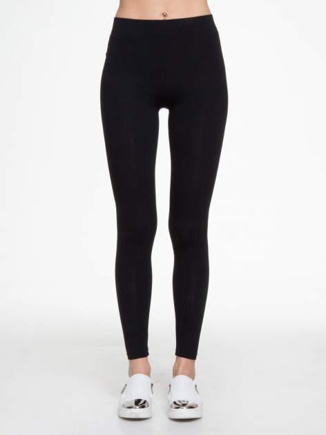 Czarne gładkie elastyczne legginsy