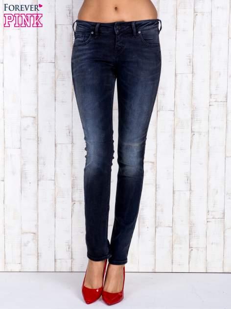 Czarne jeansowe spodnie rurki z kieszeniami i przetarciami                                  zdj.                                  1