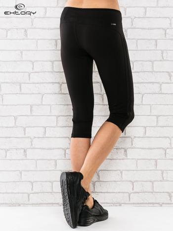 Czarne legginsy 3/4 sportowe termalne z lampasami                                  zdj.                                  3