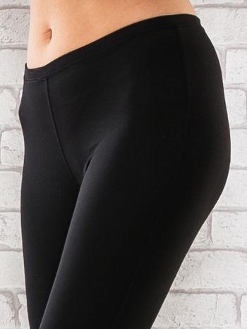 Czarne legginsy sportowe termalne z patką z dżetów                                  zdj.                                  4