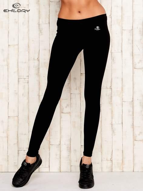 Czarne legginsy sportowe ze szwem                                  zdj.                                  1