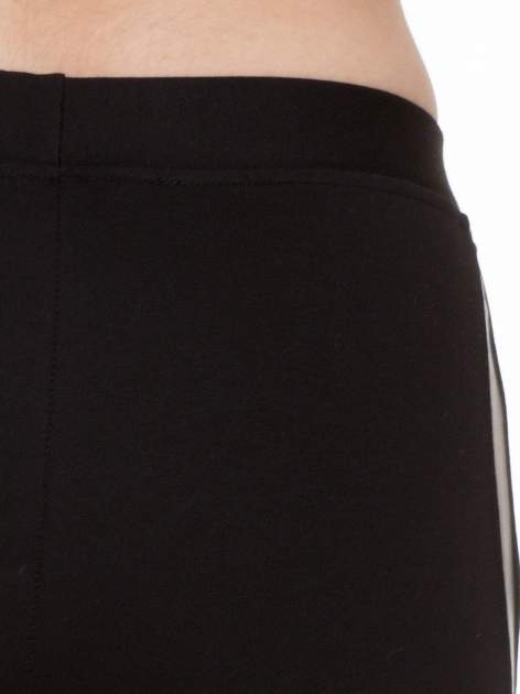 Czarne legginsy z lamapasami ze skóry                                  zdj.                                  7