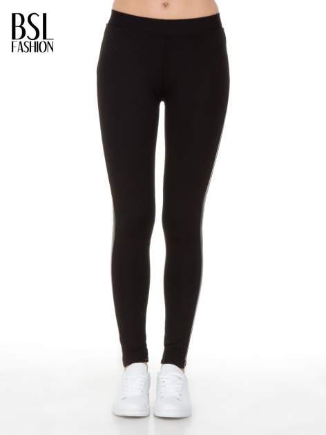 Czarne legginsy z lamapasami ze skóry                                  zdj.                                  1