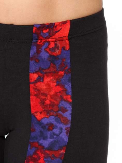 Czarne legginsy z panelami z artystycznym nadrukiem                                  zdj.                                  9