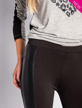 Czarne legginsy ze skórzanymi przeszyciami                                  zdj.                                  5