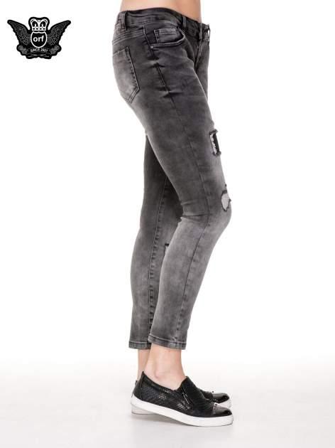 Czarne rozjaśniane spodnie jeansowe 7/8 z przetarciami i łatami                                  zdj.                                  3