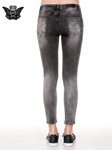 Czarne rozjaśniane spodnie jeansowe 7/8 z przetarciami i łatami                              zdj.                              6