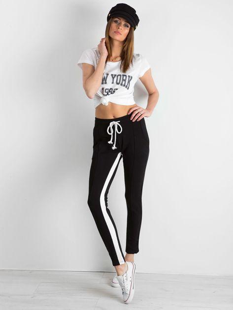 Czarne spodnie dresowe damskie Defined                              zdj.                              4