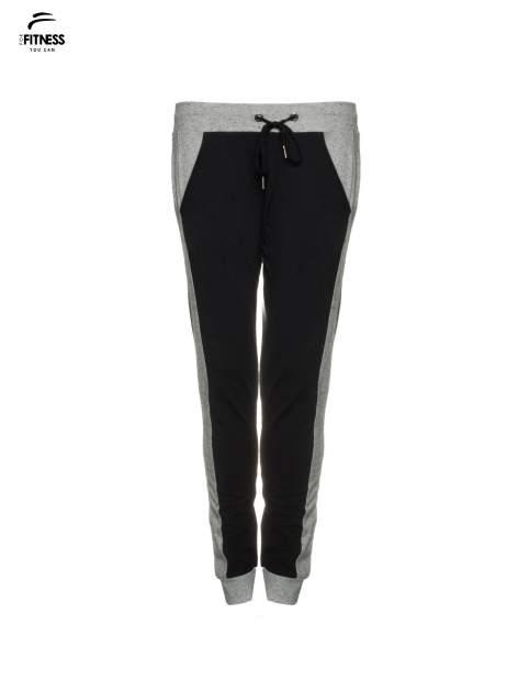 Czarne spodnie dresowe damskie z kontrastowymi lampasami po bokach                                  zdj.                                  2