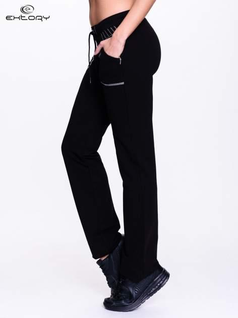 Czarne spodnie dresowe z siateczką                                  zdj.                                  3