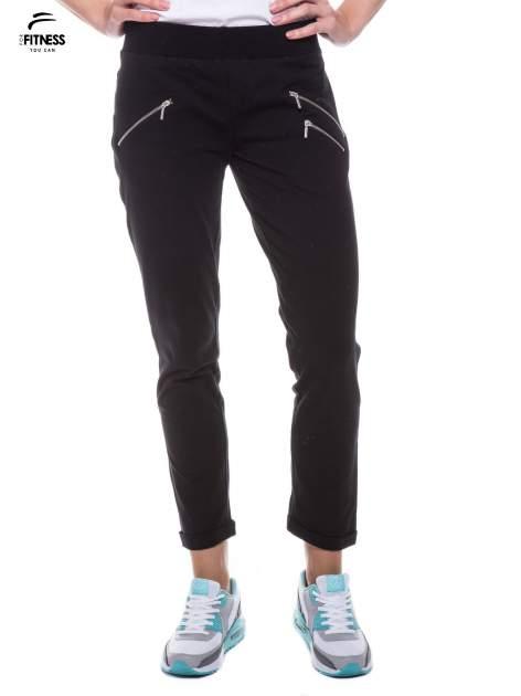 Czarne spodnie dresowe ze skośnymi zamkami                                   zdj.                                  1