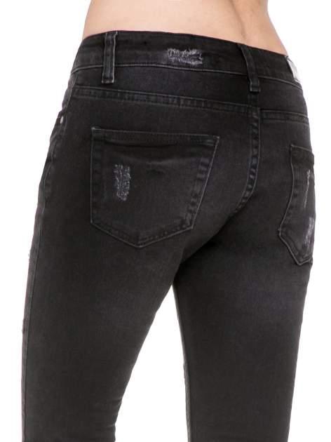 Czarne spodnie jeansowe 7/8 z rozdarciami                                  zdj.                                  9