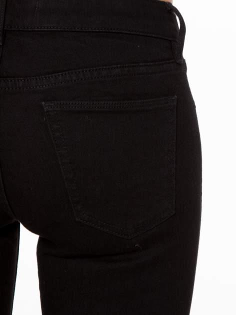 Czarne spodnie jeansowe rurki                                   zdj.                                  6