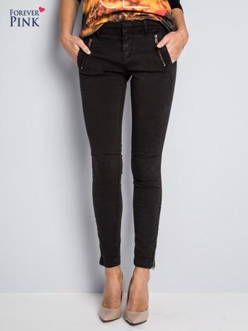 Czarne spodnie typu rurki z suwakami wzdłuż nogawek i z przodu                                  zdj.                                  1