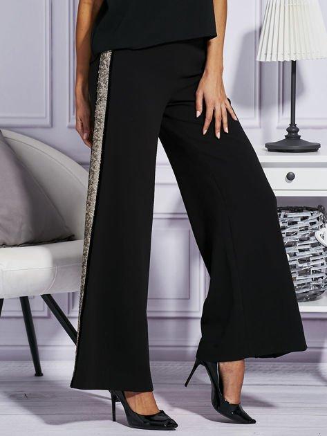 Czarne spodnie z cekinowym lampasem                              zdj.                              5