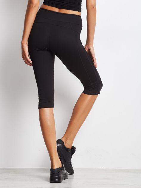 Czarne termoaktywne legginsy do biegania 3/4 z błyszczącymi lampasami ♦ Performance RUN                                  zdj.                                  1