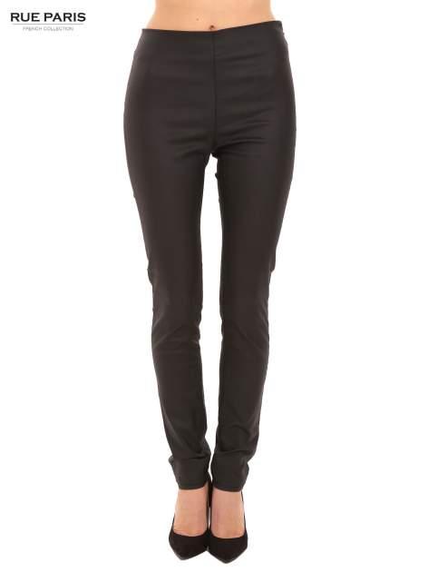 Czarne woskowane legginsy