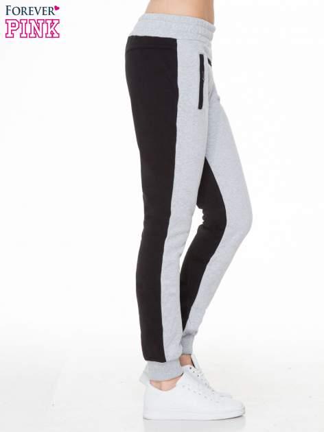 Czarno-szare spodnie dresowe two tone z kieszeniami                                  zdj.                                  3