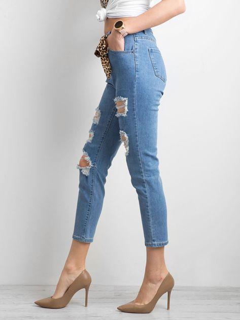 Damskie spodnie jeansowe z dziurami niebieskie                              zdj.                              3