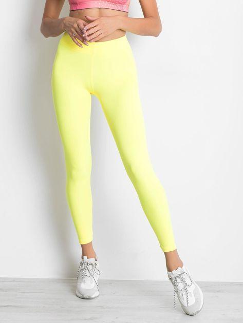 Długie fluo żółte legginsy fitness o średniej grubości                                zdj.                              1