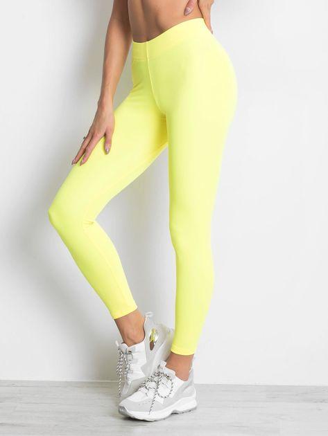 Długie fluo żółte legginsy fitness o średniej grubości                                zdj.                              3