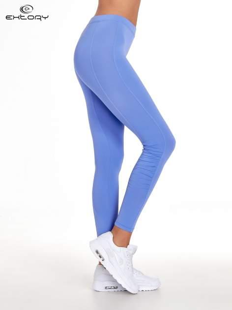 Fioletowe legginsy sportowe termalne z drapowaniem                                  zdj.                                  2