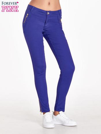 Fioletowe spodnie ze złotymi suwakami                                  zdj.                                  1