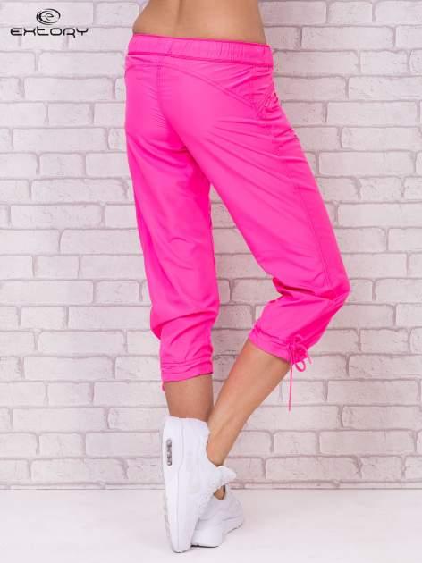 Fluozielone spodnie sportowe capri z wiązaniem                                  zdj.                                  5