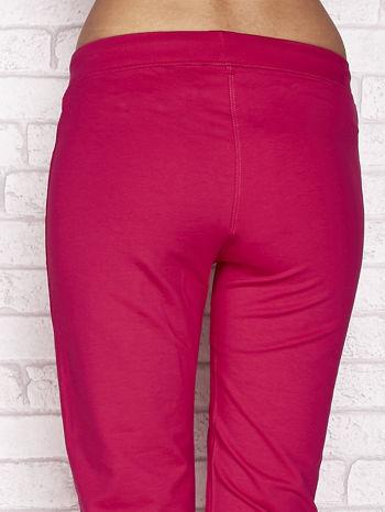 Fuksjowe spodnie dresowe capri z wszytymi kieszonkami                                  zdj.                                  6