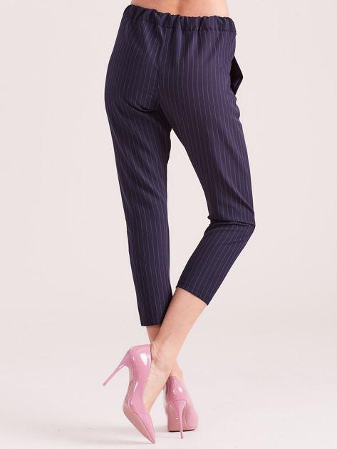 Granatowe eleganckie spodnie 7/8 w prążki                              zdj.                              2