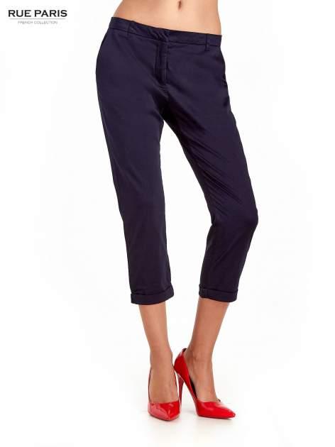 Granatowe eleganckie spodnie za kolano