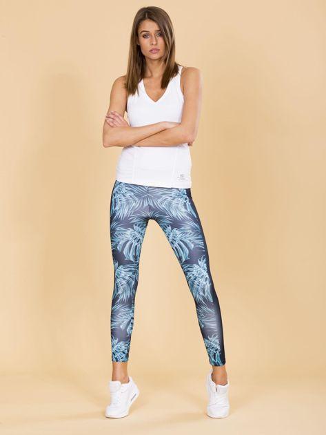 Granatowe legginsy we wzory                              zdj.                              4