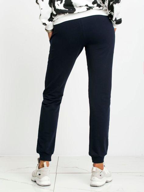 Granatowe spodnie Faster                              zdj.                              2