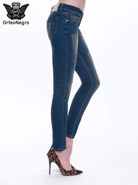 Granatowe spodnie skinny jeans z cieniowaniem i przetarciami                                  zdj.                                  2