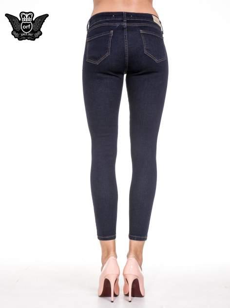 Granatowe spodnie super skinny jeans długości 7/8                                  zdj.                                  5