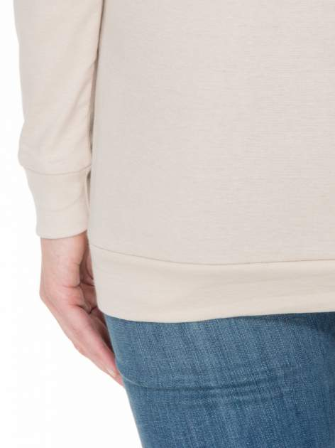 Jasnobeżowa bawełniana bluzka z rękawami typu reglan                                  zdj.                                  8