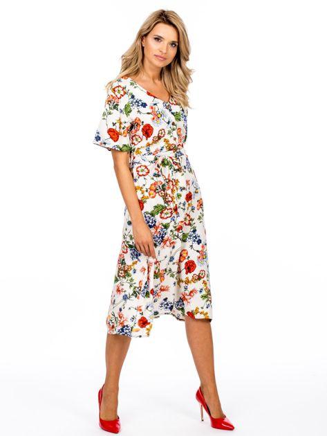Jasnobeżowa sukienka w kolorowe kwiaty                              zdj.                              1