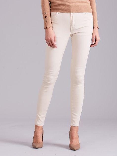 Jasnobeżowe spodnie jeansowe                              zdj.                              1
