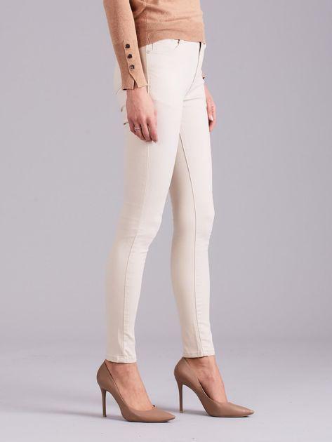 Jasnobeżowe spodnie jeansowe                              zdj.                              3