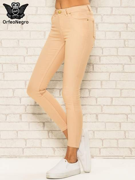 Jasnobrązowe spodnie rurki skinny z kieszeniami                                  zdj.                                  1