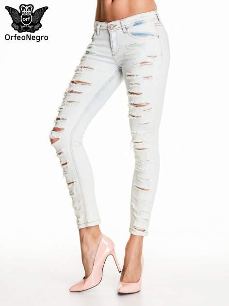 Jasnoniebieskie dopasowane spodnie trash jeans                                  zdj.                                  1