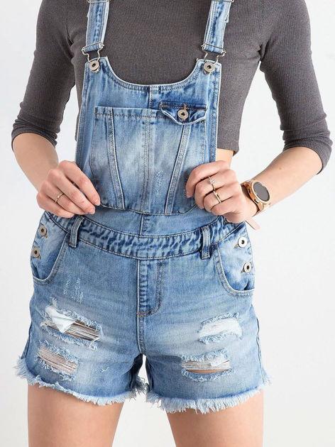 Jasnoniebieskie jeansowe ogrodniczki z dziurami