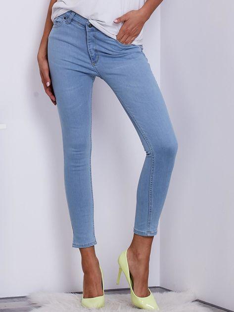 Jasnoniebieskie jeansowe spodnie ze stretchem                                   zdj.                                  1