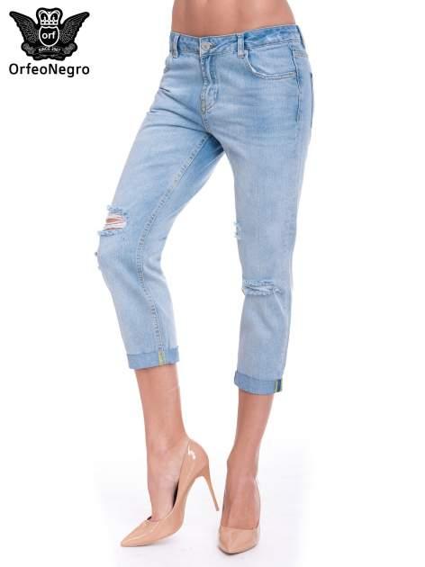 Jasnoniebieskie spodnie jeansowe 7/8  podwijaną nogawką