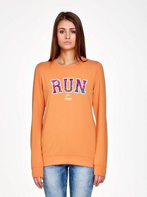Jasnopomarańczowa bluza z napisem RUN