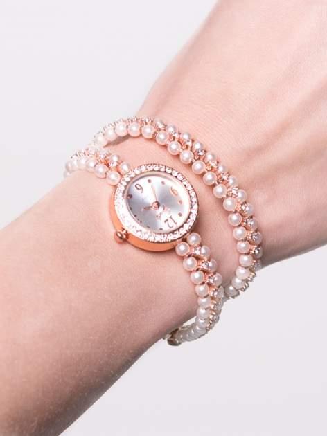 Jasnoróżowy zegarek damski na podwójnej bransolecie z pereł                                  zdj.                                  1