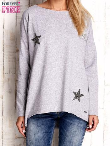 Jasnoszara bluza z błyszczącymi gwiazdkami                              zdj.                              1