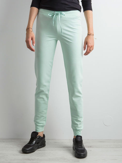Jasnoturkusowe spodnie dresowe z troczkami                              zdj.                              1